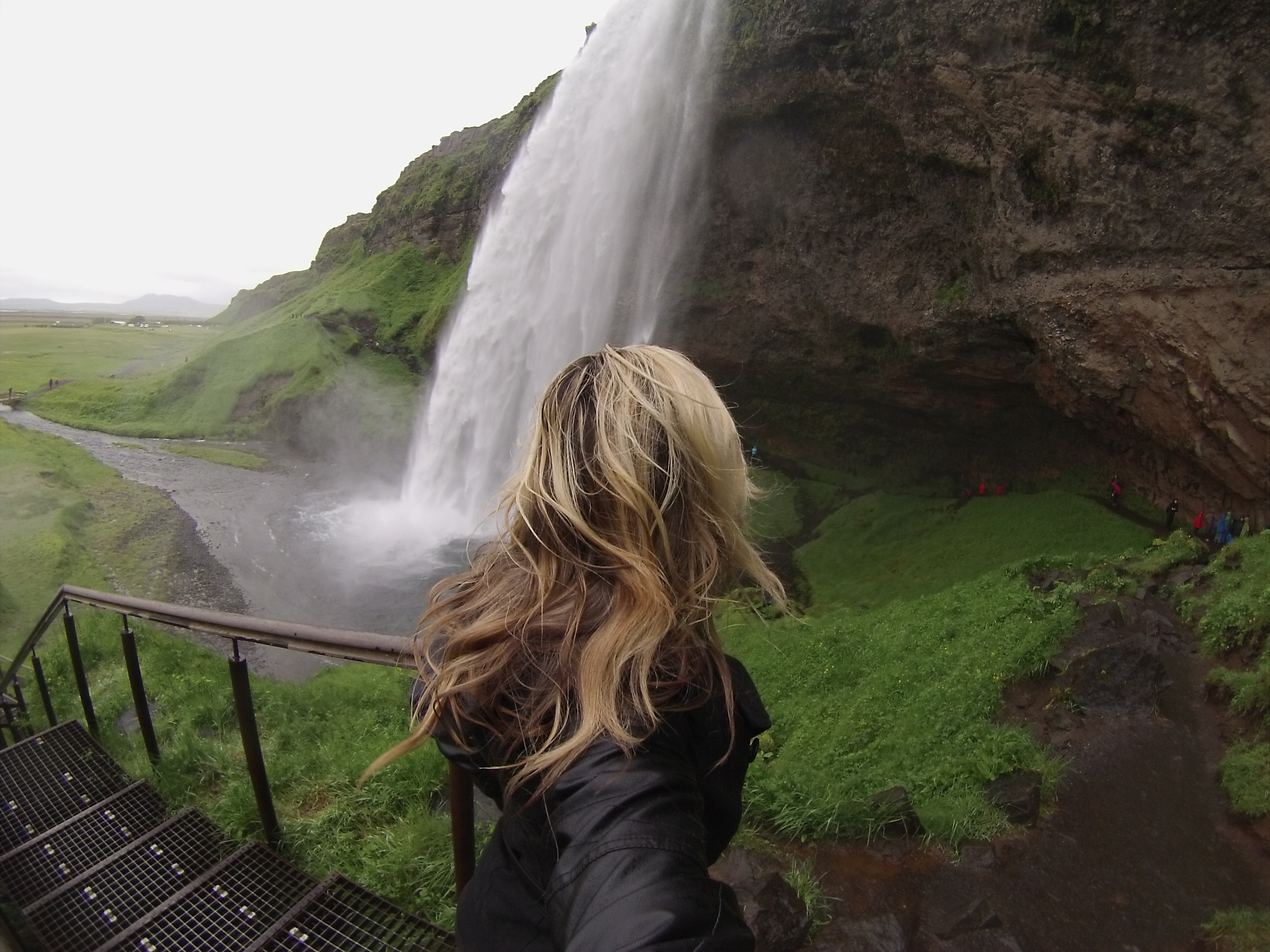 women overlooking waterfall