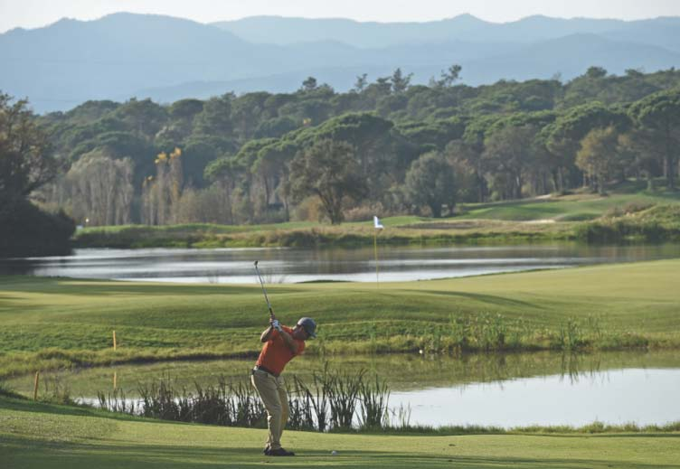 man golfing spain